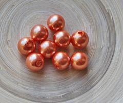 Acrylkralen  zacht oranje 12mm. Per 10 stuks.