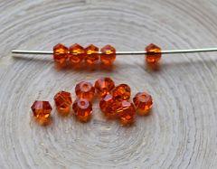 Glaskraal facetgeslepen bicone oranje, 4mm. Per 20 stuks.