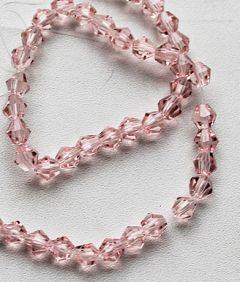Glaskraal facet bicone roze 6mm. Per 10 stuks.