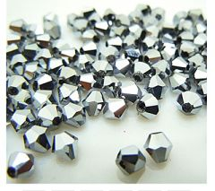 Bicone helder zilveren kleur, 4mm. 45-50st.