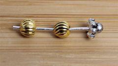 Tussenkraal rond goudkleurig 5mm. Per 5 stuks