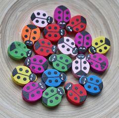 Houten kralen Lieve heers beestje kleurenmix, per 10 stuks.