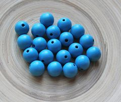 Houten kralen blauw 12mm. Per 25 stuks.