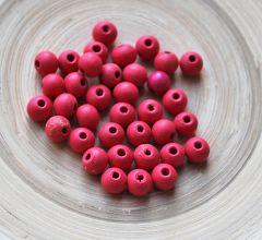 Houten kraal rood 6mm. Zakje 100 kralen.