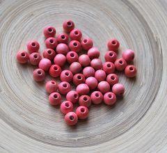 Houten roze/rode kralen 6mm. Zakje 100 stuks.
