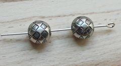 Metal look kralen zilverkleurig 10x8mm. Per 10 stuks