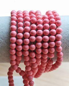 Glaskraal rond zacht roze pastel 6mm. Per 50 stuks.