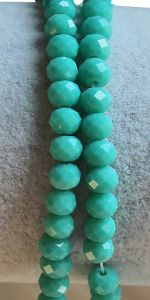 Snoer facetgeslepen turkoois opaque groene rondel 6x4,5mm.