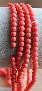 Glaskraal opaque koraal oranje 4mm, per 50 stuks.