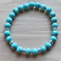 Armband blauwe turkoois kleur 8mm kralen met hematiet discs