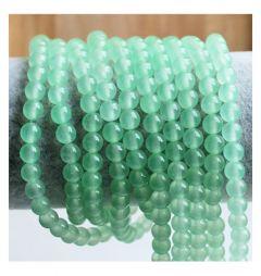 Snoer Jade zacht groen, iets transparant, 6mm