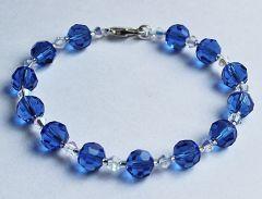 Armband blauwe facetgeslepen Kristalkralen en bicones, 19cm.