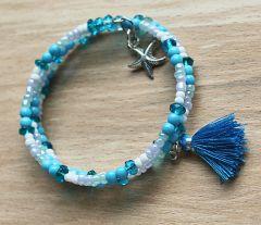 Spiraal armband Strand met kwastje en zeesterretje