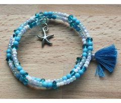 Spiraal armband Zee met kwastje en zeesterretje