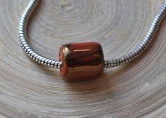 Groot gat style keramieke ring breed donker topaz-goud