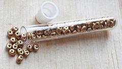 Superduo glaskralen Crystal-bronze Pale Gold, buisje met 6 gram