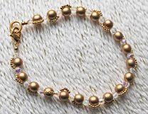 Armband  ronde goudkleurige tsjechische glaskralen
