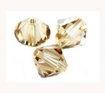 Swarovski bicone Golden crystal shadow 4mm. Per 4 stuks.