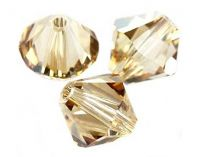 Swarovski bicone Crystal golden shadow 6mm . Per stuk.