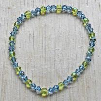 Armband 4mm licht blauwe Bicone met AB en zacht groene kralen