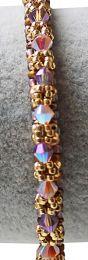 Armband Bangle kleurig met roze/amethist bicones 2x AB. 19cm.