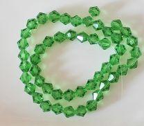 Glaskraal facet bicone groen. 6mm. Per 10 stuks.