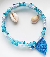 Spiraal armband Strand met kauri schelpjes