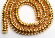 Kraal Hematiet disc heldere goudkleur 4x2mm. Per 90 stuks.