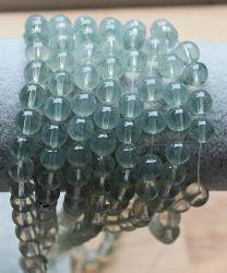 Glaskraal rond zachtgrijze kristalkleur, 6mm. Per 50 stuks.