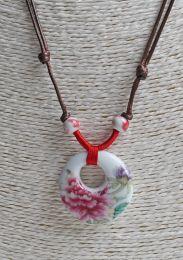 Halsketting met roze bloem donut hanger