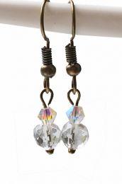 Oorbellen Bergkristal met Swarovski bicone, koperkleurige oorhaakjes