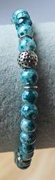 Armband gemêleerd  blauwe 6mm kralen