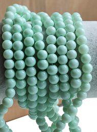 Glaskraal rond opaque Aquamarijn kleur, 6mm. Per 50 stuks.