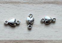 Tussenzetsel DQ Hartje zilverkleur met twee oogjes