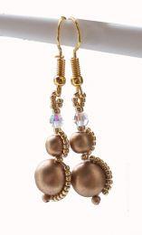 Oorbellen ronde goudkleurige tsjechische glaskralen met kristal