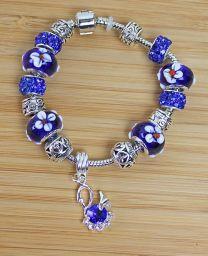 Armband Pandora style met blauwe bloemkralen en zwaan hanger, 18cm.