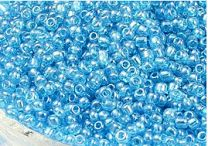Rocailles licht blauw met luster 12/0. Per 10 gram.