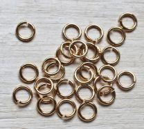 Buig ring goudkleurig 5mm. Per 50 stuks.