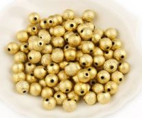 Acryl kraaltjes mat goudkleurig stardust 4mm. Per 40 stuks.
