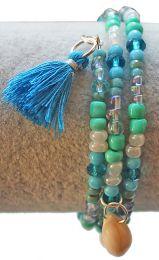 Spiraal armband Zee met kauri schelpjes